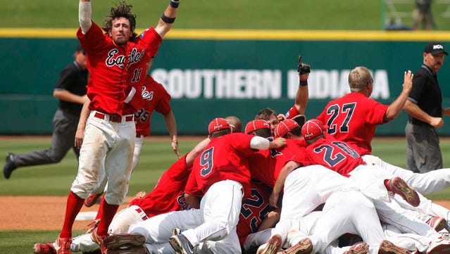 Wes Fink (11) and his University of Southern Indiana Screaming Eagles teammates celebrate after winning the NCAA Div. II Baseball Championship on Saturday afternoon. USI defeated UC-San Diego 6-4 to win the NCAA Div. II Baseball National Championship. (WG Sports Photos/Willis Glassgow)