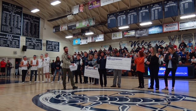 Checks were presented to two organizations for Thomas Fire relief at a Camarillo High School basketball game Friday evening.