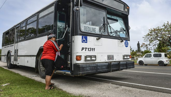 In this file photo, a Guam Mass Transit customer boards a Red Line bus at the Paseo Loop in Hagåtña on April 14.
