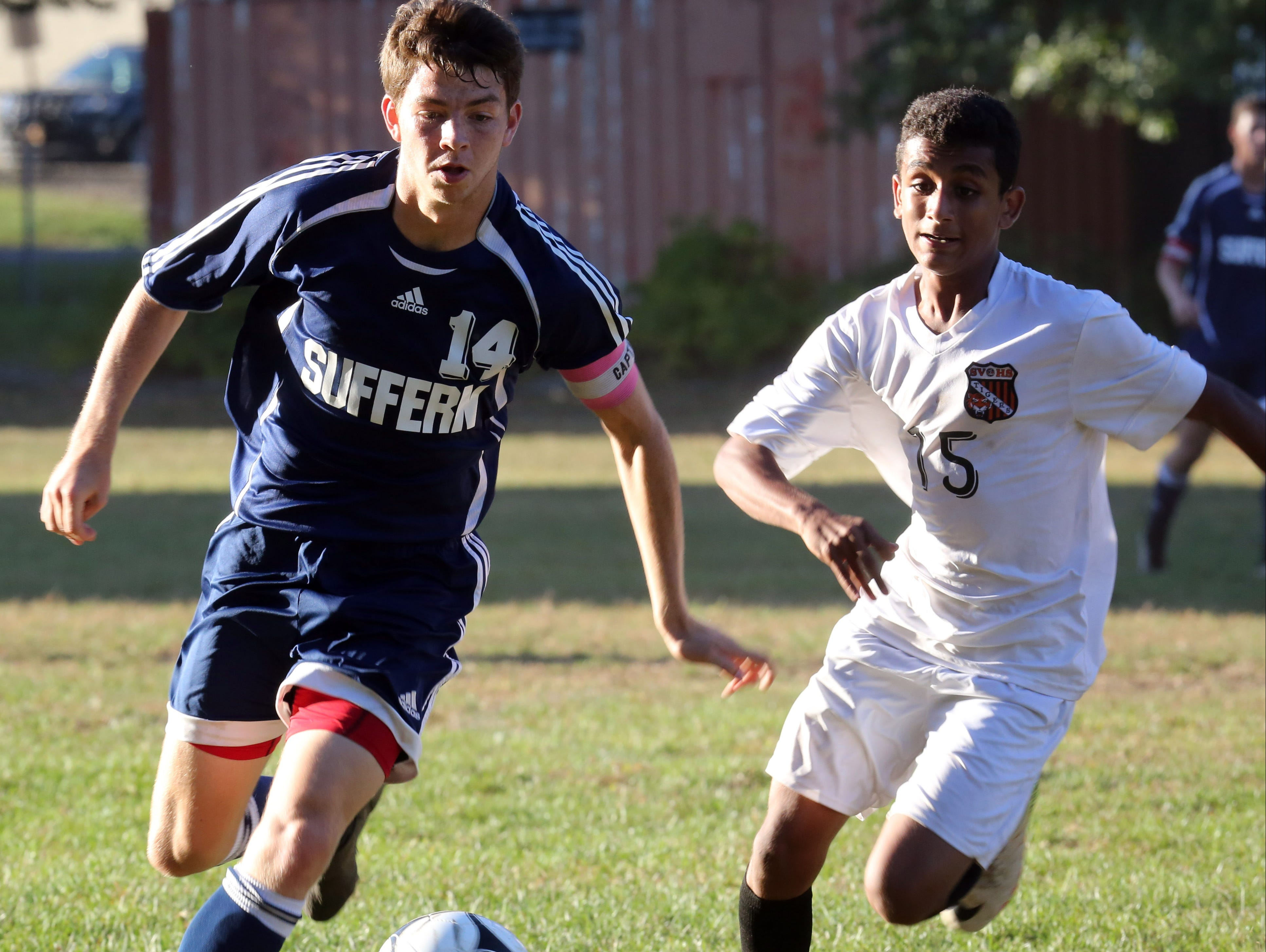 Suffern's Zac Lloyd (14) and Spring Valley's Ahmed Aly (15) battles for control of the ball during boys soccer at Spring Valley High School on Oct. 6, 2016.