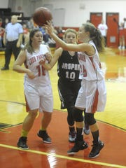 Norfork's Ivy McGowan, right, passes into the paint as teammate Abbie Belding, left, sets a screen and Jasper's Kayce Villines defends during the Lady Panthers' 47-41 loss on Tuesday at Norfork.