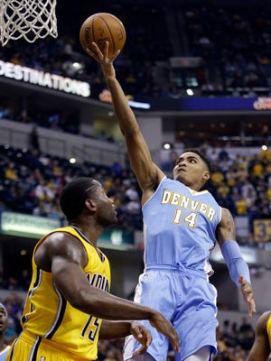 Denver guard Gary Harris (14) shoots against the Indiana Pacers during a game last week. The rookie has appeared in just two games for the Nuggets this season.