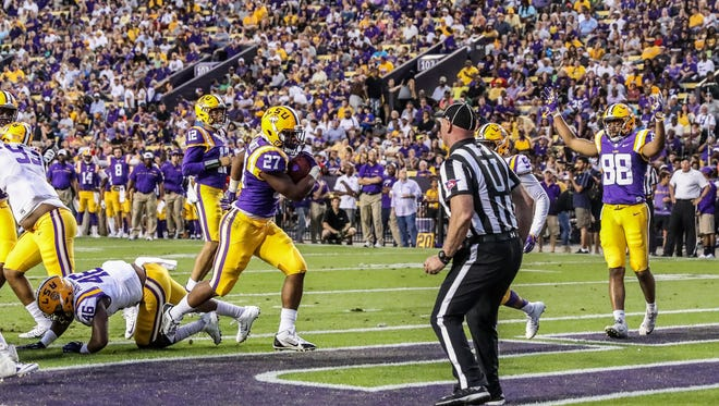 Apr 22, 2017; Baton Rouge, LA, USA; LSU Tigers running back Lanard Fournette (27) scores a touchdown against defensive end Andre Anthony (46) during the second quarter of the annual LSU Tigers purple-gold spring game at Tiger Stadium. Mandatory Credit: Stephen Lew-USA TODAY Sports