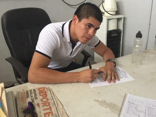 "Diego De La Hoya signs his contract to fight Randy Caballero at the ""El Condor"" boxing gym in Mexicali where he trained as a child."