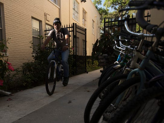 Harry Figueroa test rides a bike at Working Hands Ministry