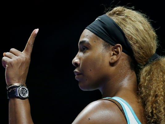 Serena Williams of the US gestures to the chair umpire during her singles match against Canada's Eugenie Bouchard at the WTA tennis finals in Singapore,Thursday, Oct. 23, 2014. (AP Photo/Mark Baker)