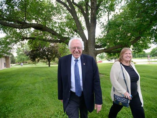 Bernie and Jane Sanders arrive at Muscatine Community