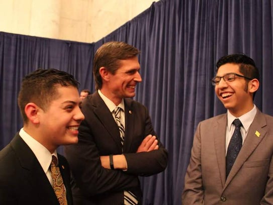 Andre Gonzales, right, visits with Sen. Martin Heinrich