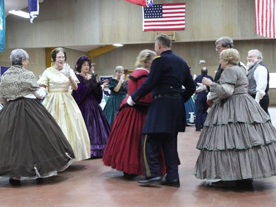 Dancers follow directions of caller Lee Millar during