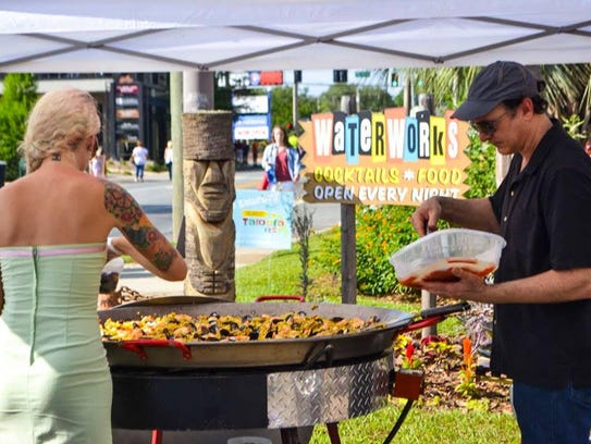 A patron enjoys paella at the first Taloofa Fest in