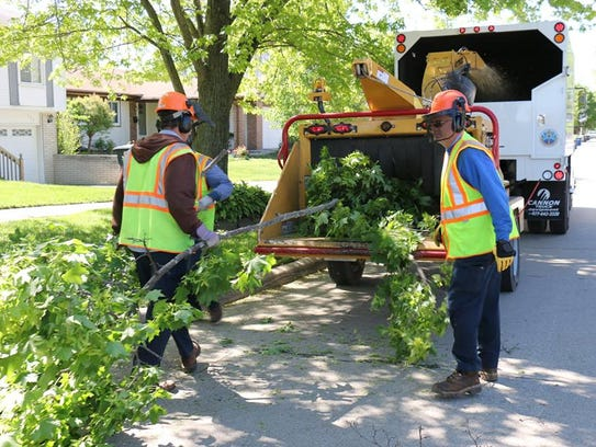 Westland Department of Services crews cleaning up after
