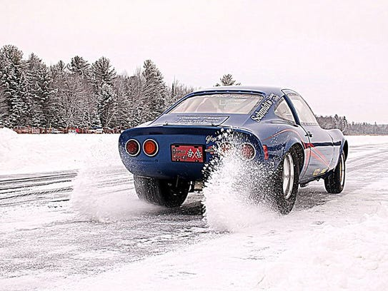 A car spins its wheels during the Merrill Ice Drags.