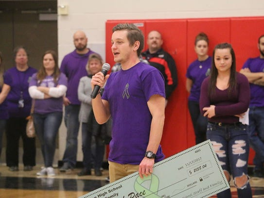 Josh Pace speaks at a pep rally at Harding High School