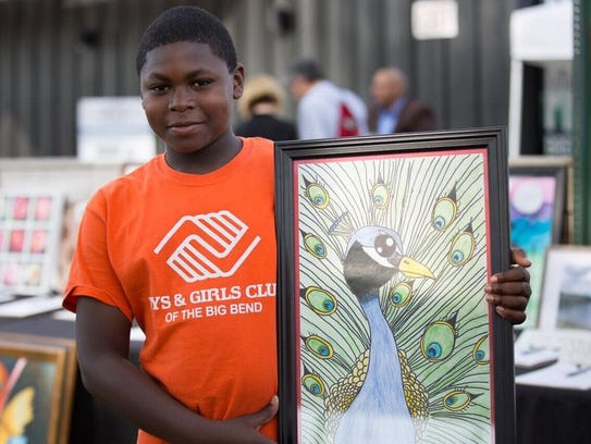 A Club member shows off his artwork.