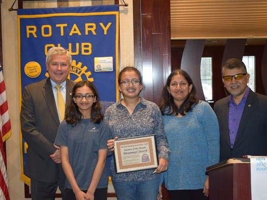 Hiranmay Suresh and her family with Kip Bateman (left)