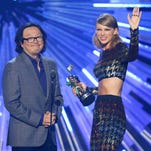 """In this Aug. 30, 2015, file photo, director Joseph Kahn, left, and Taylor Swift appear on stage as Swift accepts the award for female video of the year for """"Blank Space"""" at the MTV Video Music Awards in Los Angeles."""