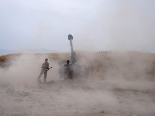 Afghan National Army soldiers fire artillery during