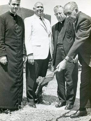 State Commissioner of Correction Paul D. McGinnis, right, turns over a spade full of dirt at the groundbreaking for the Chapel of St. Paul's Church inside the Green Haven Prison in July 1966. From left are Green Haven Prison Chaplain the Rev. Edward J. Donovan, warden Harold W. Follette and the Rev. James. E. McManus, auxiliary bishop of New York.