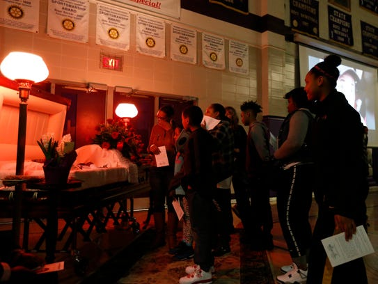 Classmates and community members shed tears Wednesday,