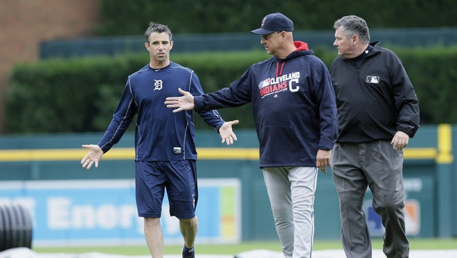 Tigers manager Brad Ausmus, left, inspects the field at Comerica Park with Indians manager Terry Francona and umpire Hunter Wendelstedt during a rain delay on Sept. 29, 2016 in Detroit.