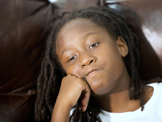 In the first few weeks after the shooting death of his father, Samuel Vincent DuBose Jr., then 9, listens to his mother, DaShonda Reid, talk about her fiance, Sam DuBose.