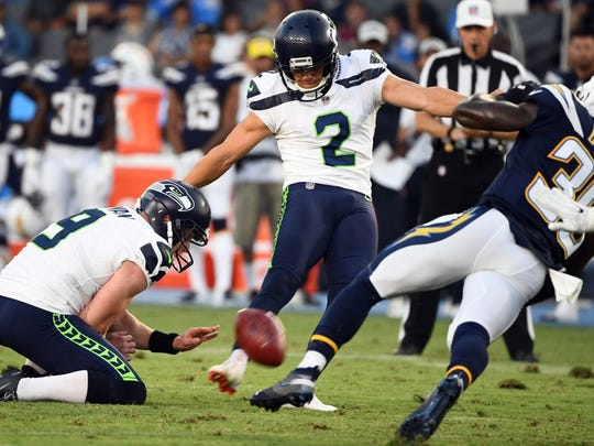 Aug 18, 2018; Carson, CA, USA; Seattle Seahawks kicker Jason Myers (2) kicks a 33 yard field goal out of the hold of  punter Jon Ryan (9) against the Los Angeles Chargers at StubHub Center. Mandatory Credit: Robert Hanashiro-USA TODAY Sports