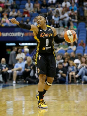 Tulsa Shock guard Odyssey Sims gestures to teammates against the Minnesota Lynx on June 5, 2015.
