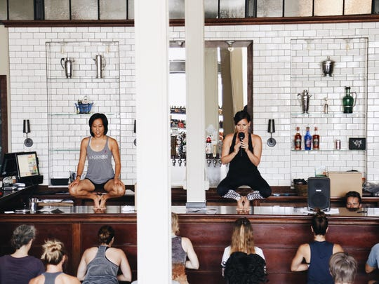 Detroit Community Yoga teachers lead a class for charity