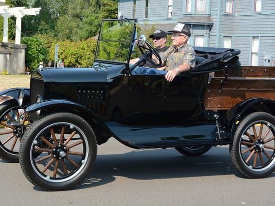 Wilbur Vanderbeck drives his 1924 Ford Model-T with son, Carey, in the Homer Davenport Community Festival Parade on Saturday, Aug. 2, 2014. Carey Vanderbeck restored the car as a gift for his parents 60th wedding anniversary ion July.