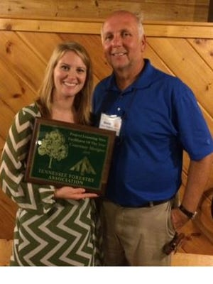 Courtney Morgan, education specialist for Smyrna Parks and Recreation, was recently presented Tennessee's Outstanding Project from Dave Walters,  co-coordinator of Tennessee Project Learning Tree.