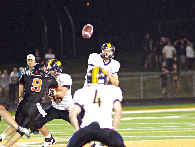 during a game at Solon Stadium on Aug. 29, 2014. Solon snapped Regina's 56-game winning streak, winning on a two-point conversion in overtime, 29-28.