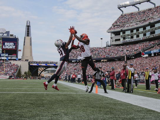 A.J. Green goes up for a contested catch in New England.