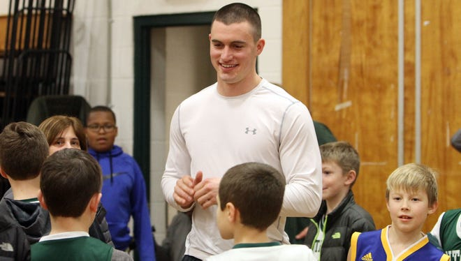 Former Pleasantville athlete Jack Bramswig talks to a group of young athletes at Pleasantville High School Jan. 25, 2017. Bramswig is playing minor league football in Green Bay, Wisconsin, and is hoping to make it to the NFL.