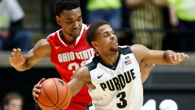 P.J. Thompson works the ball at the top of the key against Ohio State's Keita Bates-Diop Thursday, January 21, 2016, at Mackey Arena. Purdue defeated Ohio State 75-64.