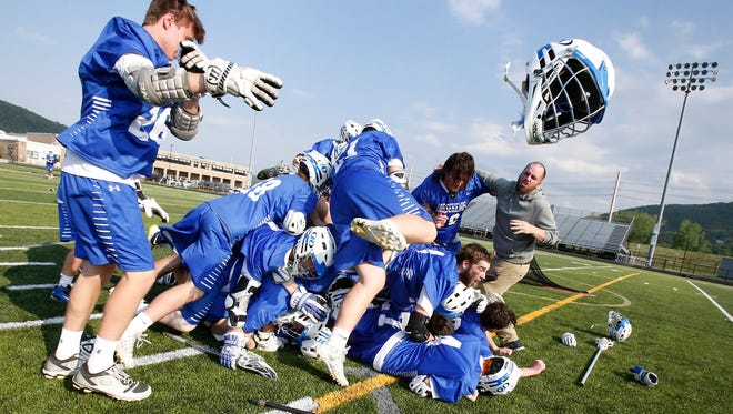Horseheads lacrosse players rejoice as they storm the field Thursday after defeating Vestal 13-11 in the Section 4 Class B finals at Corning-Painted Post stadium.