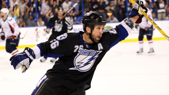 Martin St. Louis' jersey will be retired by the Tampa
