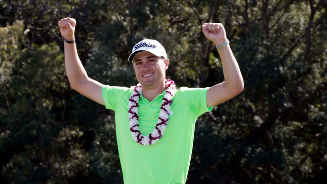 Jan 8, 2017; Maui, HI, USA; PGA golfer Justin Thomas reacts after winning the Tournament of Champions golf tournament at Kapalua Resort - The Plantation Course. Mandatory Credit: Brian Spurlock-USA TODAY Sports