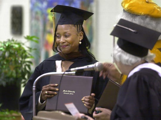 May 11, 2001: Paula Cooper receives a bachelor's degree in humanities from Martin University.