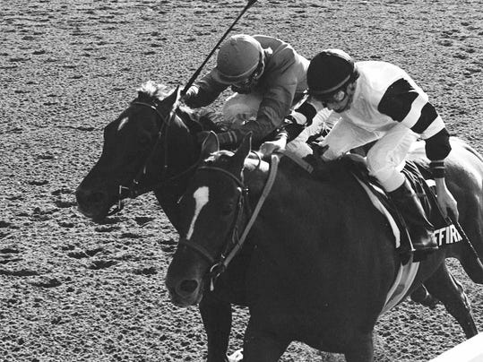 FILE - In this June 10, 1978 file photo, Affirmed, Steve Cauthen up, right, battles Alydar, Jorge Valasquez up, down the stretch of the Belmont Stakes at Belmont Park in Elmont, N.Y. Now 36 years have passed since Cauthen, who was then 18, teamed with Affirmed to hold off Alydar in three thrilling races, capped by their victory by a head in the Belmont.  (AP Photo/File)