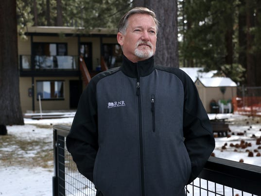 Stu Roberson of RnR Vacation Rentals checks out the lake from one of his rental properties in South Lake Tahoe on Feb. 20, 2018.