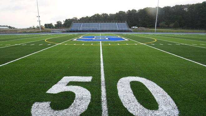 The sun rises, Aug. 27, 2020, over the new artificial turf at Bob Diffenbacher Field at Seneca High School in Greene Township. The field will not be used until Oct. 3 so that all renovations may be completed.