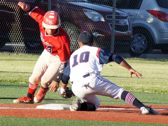 Grants base runner Ronnie Gonzales avoided the tag