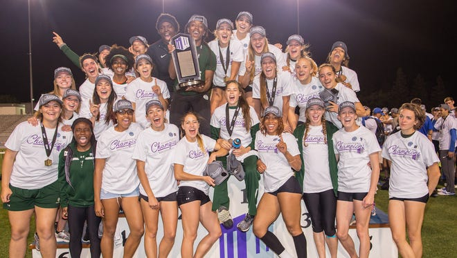 The women on CSU's track and field team celebrate late Saturday night after winning the Mountain West outdoor title for the second year in a row in Clovis, Calif.