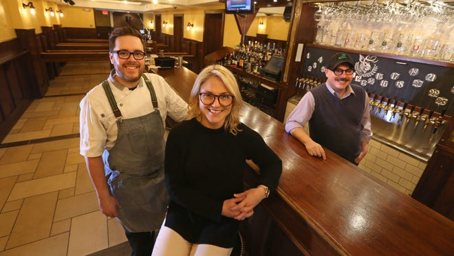 Derrick DePorter, owner and chef, left, stands with Ericka Wilson, assistant general manager, and Drew Pearman, bar manager, at Unter Biergarten, a German-style beer hall at 120 East Ave. (in the space that formerly housed Victoire) Tuesday, Feb. 13, 2018 in Rochester.