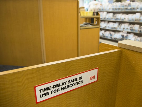 Signage announcing a time-delay safe system for prescription drugs is now in use at the CVS at the corner of Meridian and 16th streets in Indianapolis.