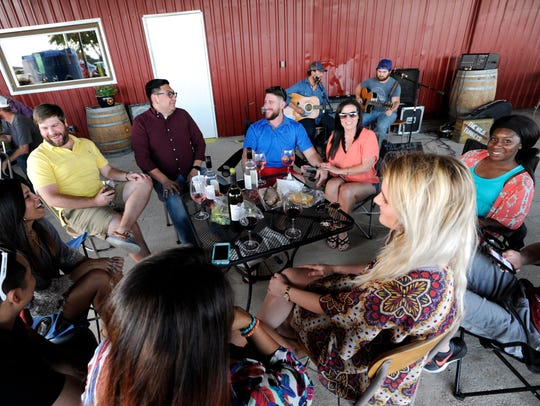 Diners spend the evening at the Star of Texas Winery