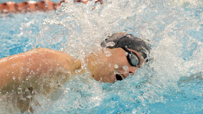Gulf Breeze native P.J. Dunne swims during competition for the Texas Longhorns.