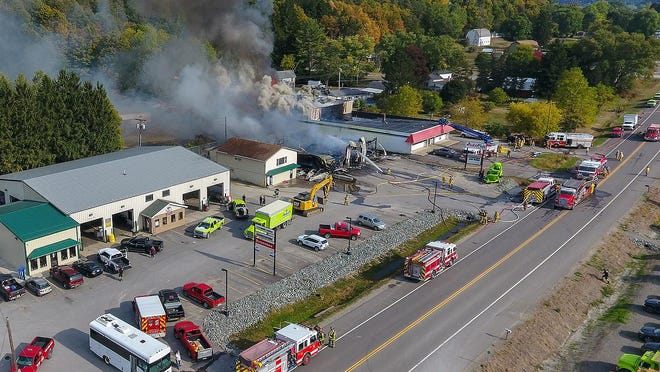 Firefighters battled a blaze for hours Thursday at T&R Environmental Services in Bath.