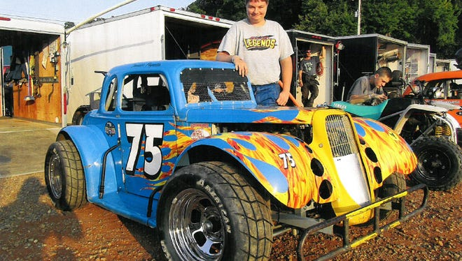 Chandler Pagnotta poses with his legend car.