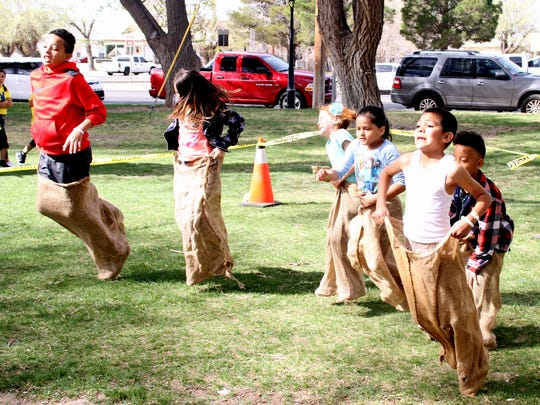 Potato sack races were one of many side attractions during Saturday's Easter Egg Hunt at Luna County Courthouse Park.